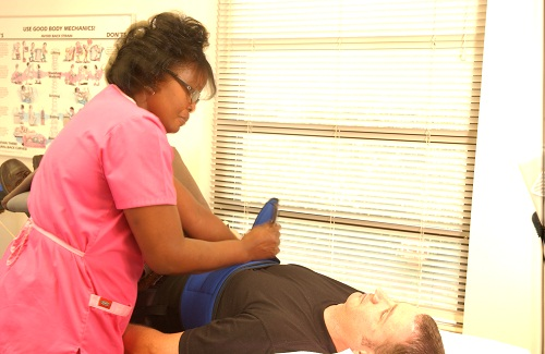 A hurt patient being treated at ChiroCarolina®
