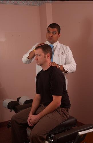 Chiropractors examines patient neck pain