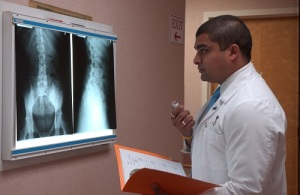 Dr. Ali checking lab results for low back pain