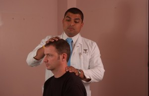 Chiropractor treating patient suffered from Charlotte Headaches