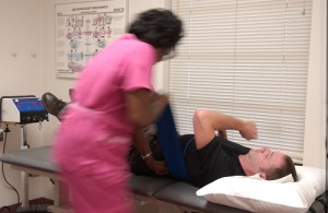 Chiropractor treating patient injured at Work